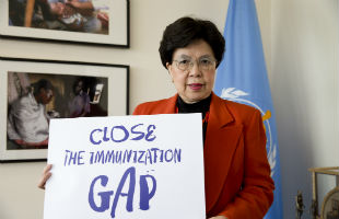 Dr Margaret Chan, Director-General of WHO, holds a sign reading