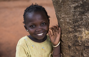 Girl from Central African Republic smiling.