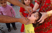 A child is administered the OPV during the polio measeles NID campaign in Iraq 14-18 September 2014.